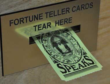 Fortune telling card coming out of Zoltar arcade machine