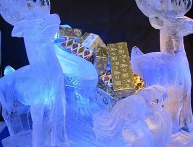 Reindeer and sleigh ice sculpture