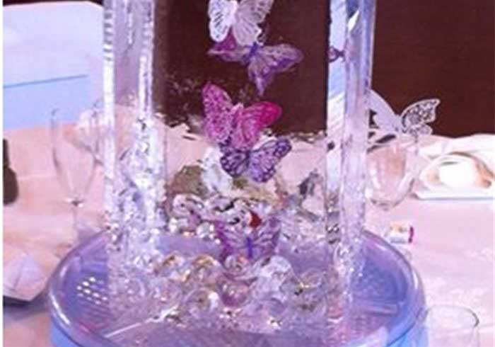Flowers in an ice sculpture table centre