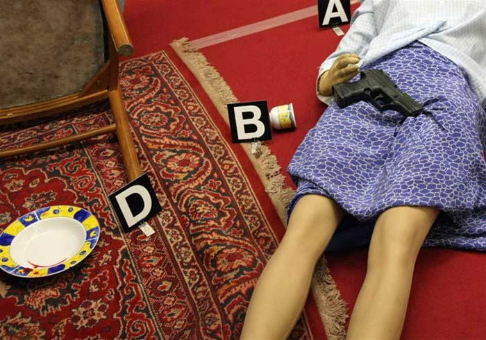 Dead body at a murder mystery