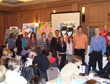People on stage at team building presentation