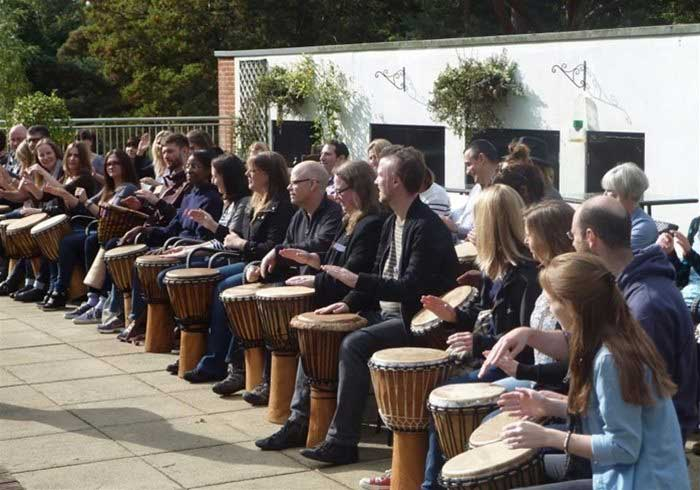 People drumming at a team building event