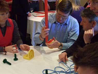 A group solving a team building puzzle