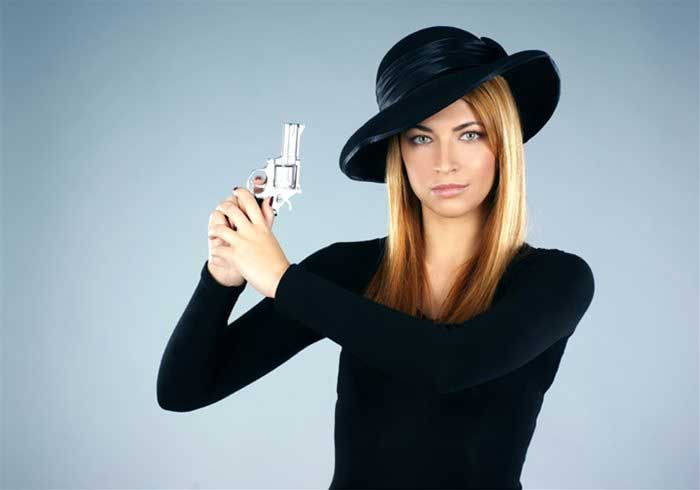 Murder Mystery actress with a gun