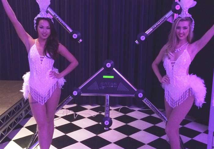 Showgirls standing by a Batak Wall