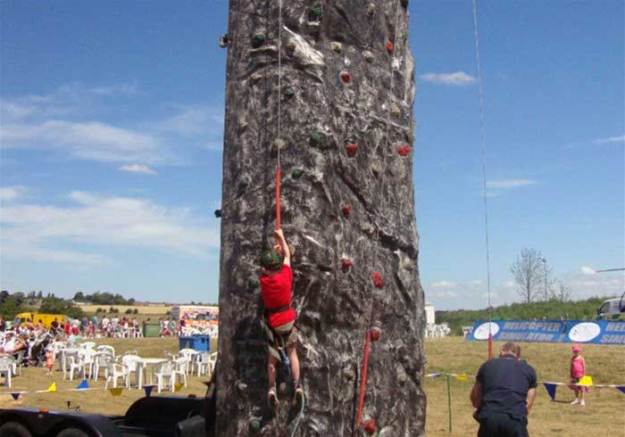 A climbing wall at a fun day