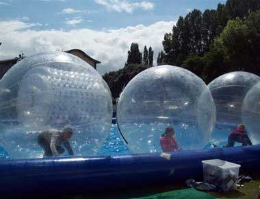 Water Zorbs in an inflatable pool
