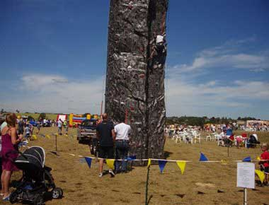 A climbing wall in a field