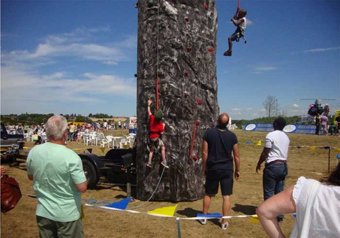 Children Climbing a mobile climbing wall