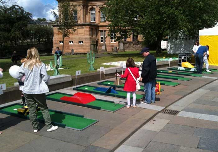 People playing Crazy Golf