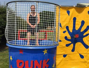 Lady sitting on a dunk tank