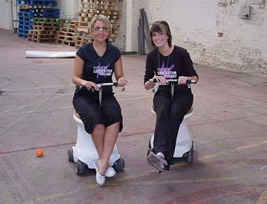 Ladies sitting on racing toilets