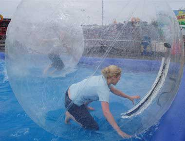Lady in a zorb ball on water